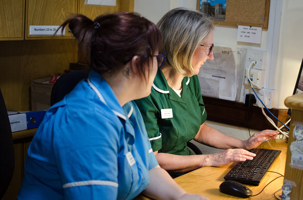 Thameshospice 2 people and keyboard